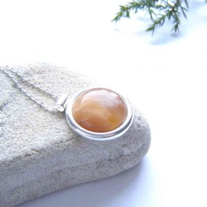 Orange Banded Carnelian Agate Pendant. in handcrafted, natural, peach orange British carnelian agate. I have collected this natural stone in the Northumbrian region of England, in the United Kingdom.