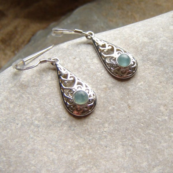 Natural Green Apatite Drop Earrings. Antique style earrings are in sterling silver filigree set with tiny apatite cabochons. The apatite is a semi-precious stone, which has been found in the Northumbria region of England.