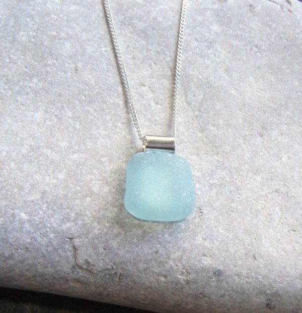 Aqua Sea Glass Square Necklace The sea glass for this necklace has been hand-collected on the Northumbrian coast of England, after being tumbled and frosted naturally over many years by the waves of the North Sea.