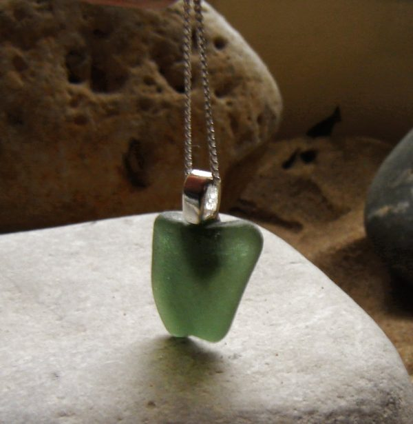 Green Bottle Sea Glass Pendant. Northumbrian Green Bottle Sea Glass Pendant necklace, hand made in sea glass from the North East coast of England, United Kingdom, set in sterling silver.