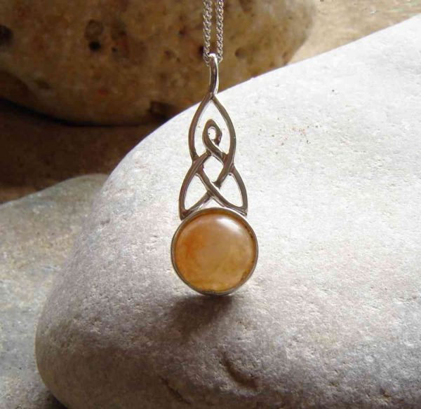 Celtic Knot Necklace in Orange Carnelian Quartz. This natural British carnelian has been collected by hand on the North East coast of England, Britain, and set in sterling silver.