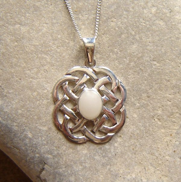 Celtic Knot Necklace in Natural White British Quartz.The quartz has been collected in Northumbria, England, hand cut and finished in sterling silver.