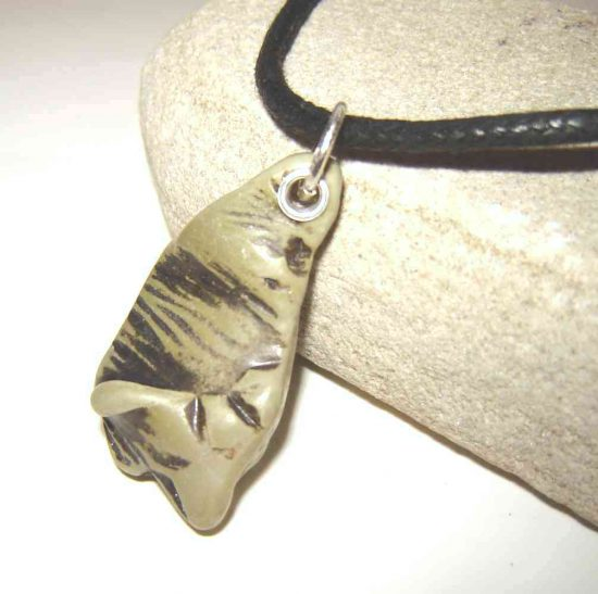 Large Green Sea Pottery Choker Pendant. This men's or women's unisex pendant necklace is handmade with sea-washed green-patterned ceramic found on the Northumbrian coast of England. Men's and Women's Sea Pottery Necklace.