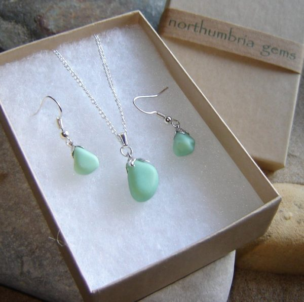 Mint Green Sea Glass Jewellery Set. Northumbrian Sea Glass pendant and earrings set in pastel or mint green. The pastel green sea glass has been hand-collected in Seaham, County Durham, England
