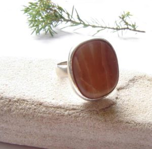 Large, handcrafted carnelian agate gemstone ring in sterling silver.