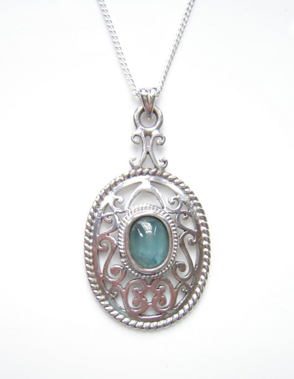 Natural blue green apatite gemstone necklace. The apatite has been found here in the North East of England, hand-shaped and set in antique style silver mount
