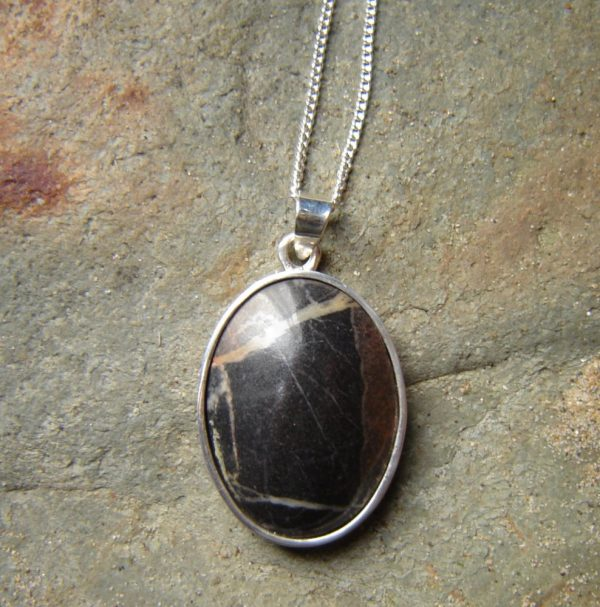 Brown Natural Stone Necklace with Fine Quartz Veins. Necklace in Brown Fine Quartz Veins British Stone. Natural pendant necklace in an oval cabochon hand cut from Northumbrian stone into an oval cabochon