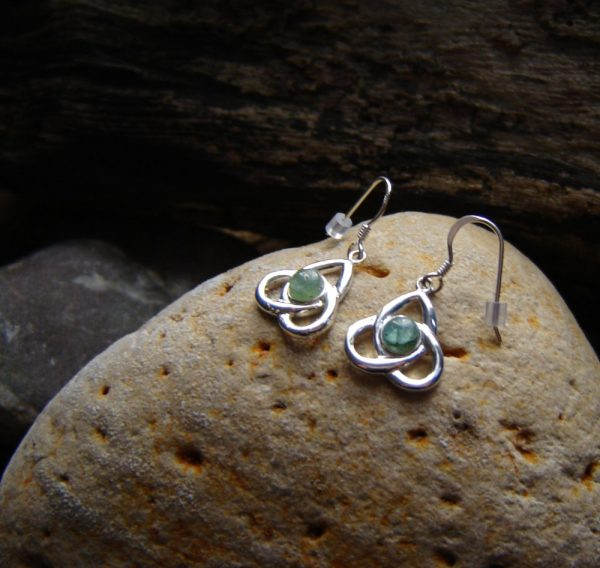 Celtic Trinity Knot Apatite Earrings. Triple or Trinity knot earrings set with green apatite, a semi-precious stone hand-shaped and set in sterling silver. Celtic Triskele Apatite Earrings in apatite hand-collected, cut and finished in the North East of England
