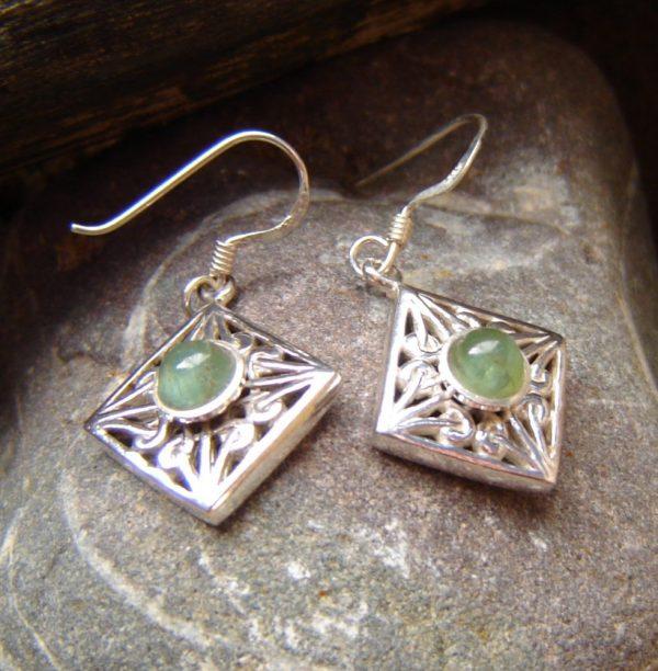 Natural Green Apatite Cabochon Earrings. Green Apatite Cabochon Earrings. These sterling silver filigree earrings hang in a diamond shape.