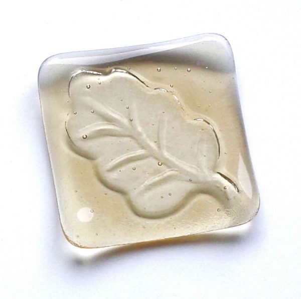 Oak leaf light amber glass ring dish. This small jewellery or trinket bowl is handcrafted in light amber-coloured glass.
