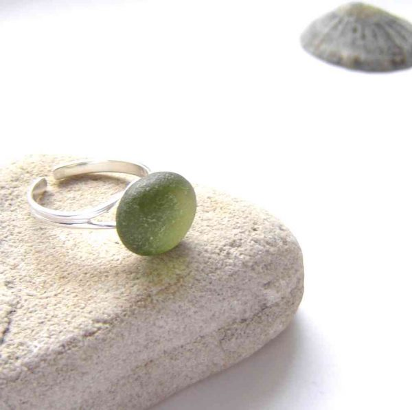 Olive Green Adjustable Sea Glass Ring. A sterling silver sea glass ring made with genuine sea glass found on the Northumbrian coast of England.