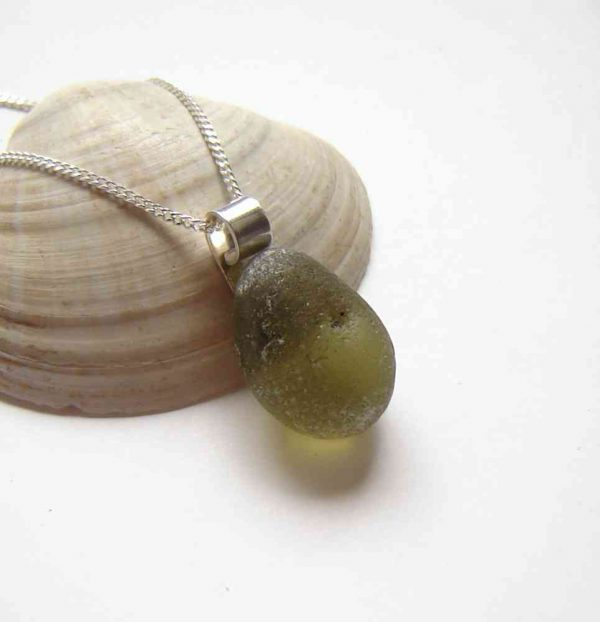 Olive Green Sea Glass Pendant. A Northumbrian sea glass necklace handmade with rounded, frosted olive green sea glass. The sea glass has been shaped and frosted naturally by the tumbling action of the North Sea, and I have collected it locally on the north-east coast of England.