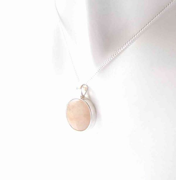 Pale Orange Natural English Carnelian Pendant. This natural carnelian has been collected by hand on the North East coast of England, Britain, and set in sterling silver.