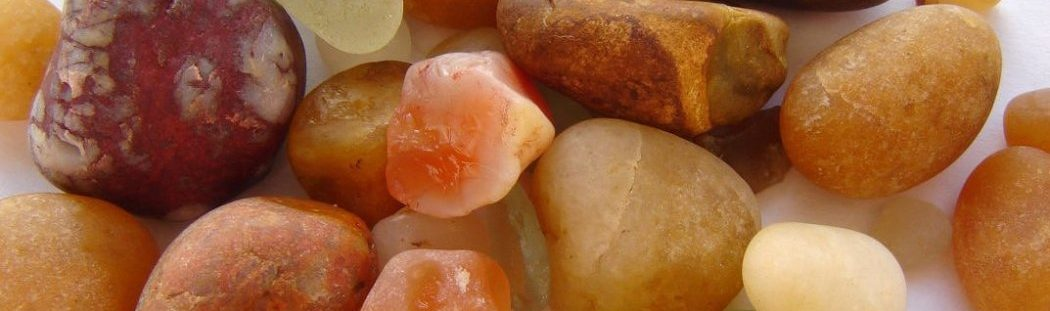 A collection of coloured British stones and sea glass for Northumbria Gems jewellery