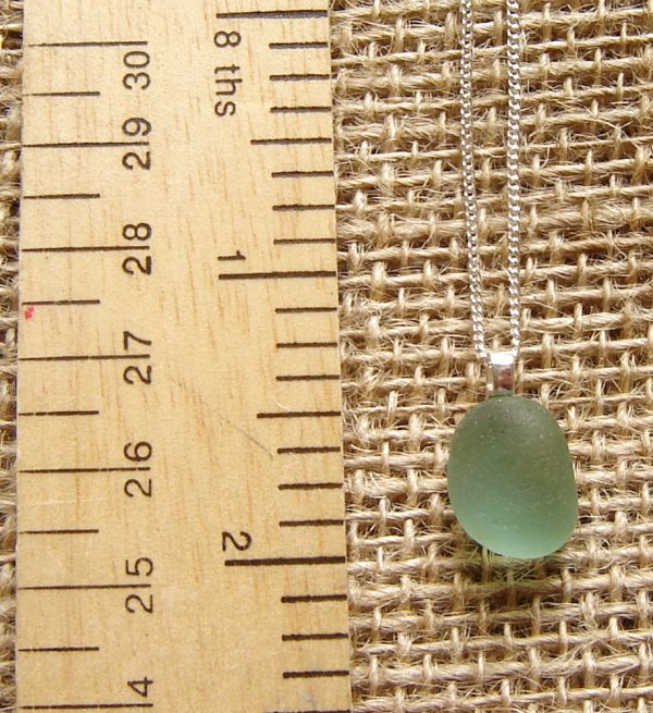 Small Blue Green Sea Glass Pendant. The sea glass has been hand-collected along the Northumbrian coast of England.