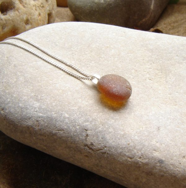 Small Brown Frosted Sea Glass Necklace, handmade in amber brown Northumbrian sea glass which has been tumbled naturally by the North Sea over many years.