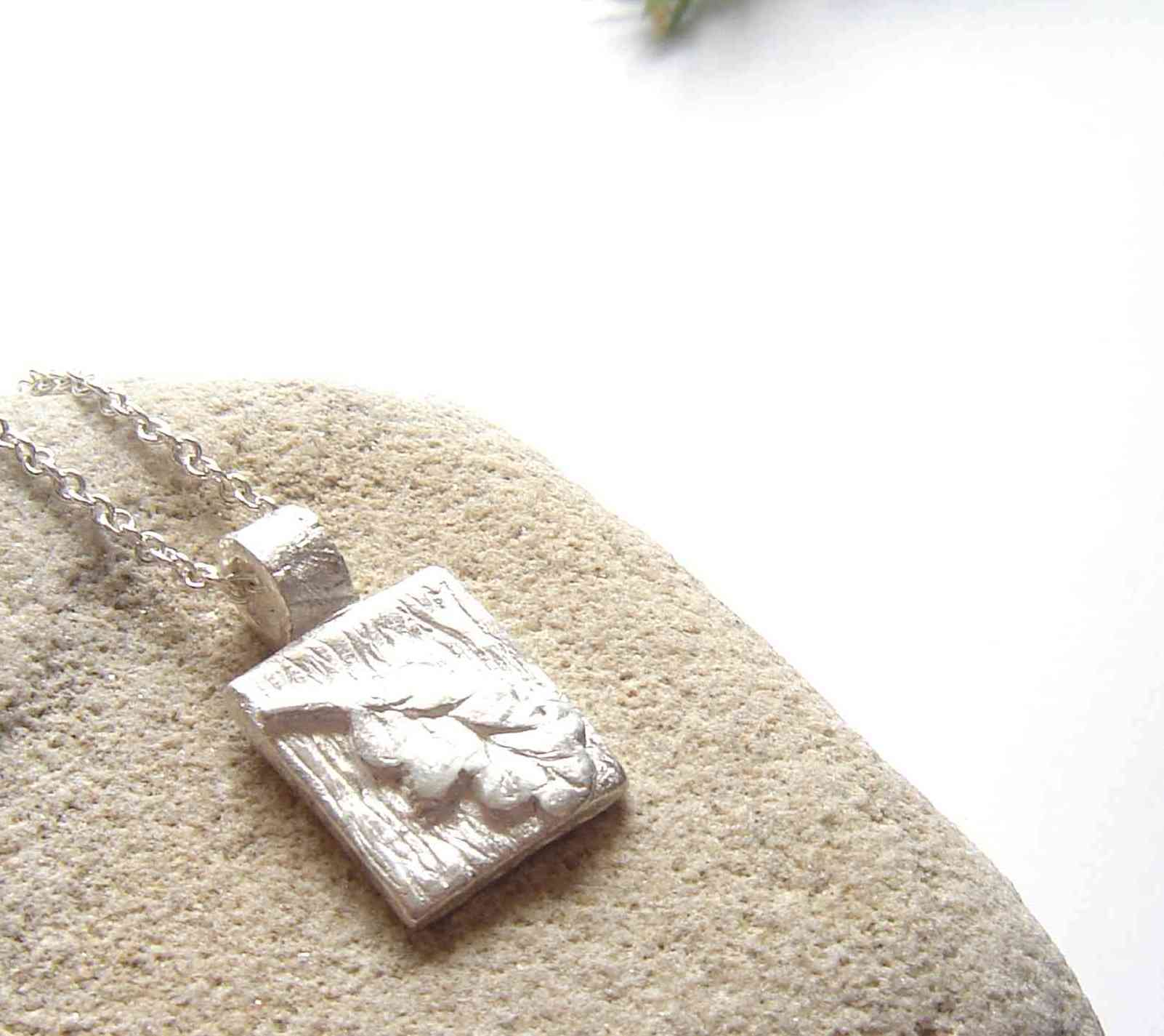 Small oak leaf silver pendant designed and handcrafted in England. Inspired by nature.
