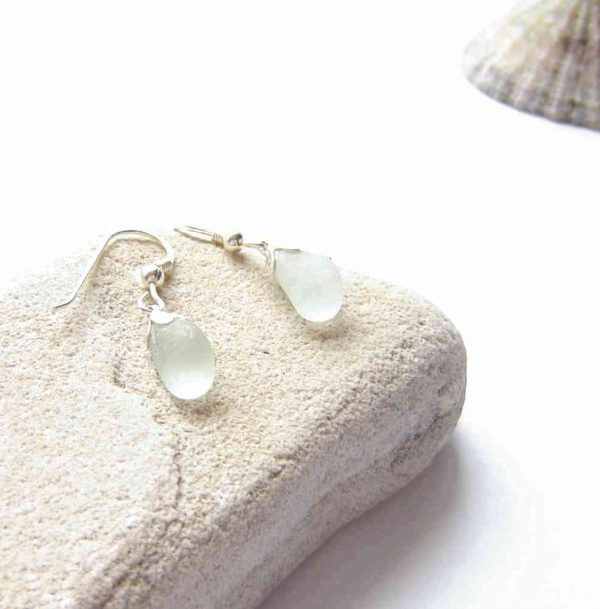 Small White Northumbrian Sea Glass Earrings. Frosted White English Northumbrian Sea Glass Drop Earrings, handmade with authentic sea glass which I have collected by hand on the North East oast of England, United Kingdom. The earrings are in sterling silver.