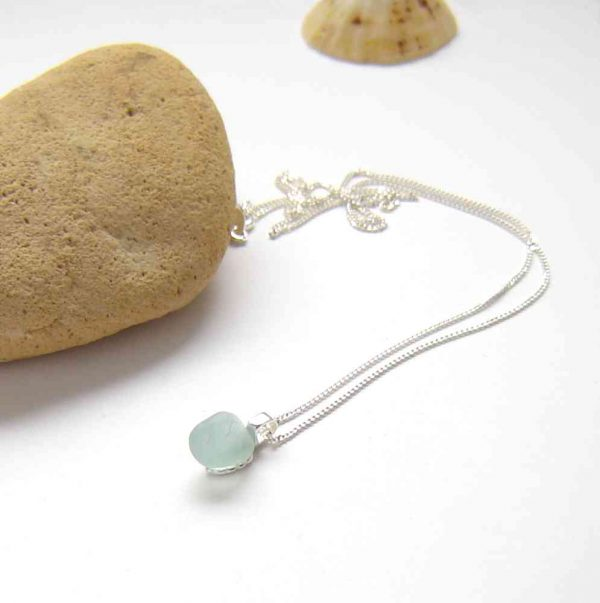 Tiny Aqua Blue Sea Glass Pendant necklace handmade in sterling silver and genuine English sea glass from the beaches of Northumbria