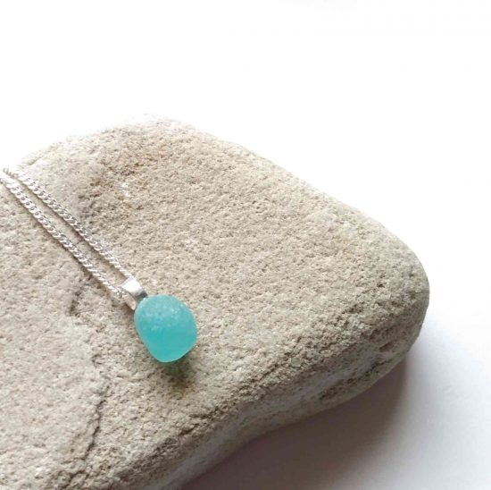 Tiny Turquoise Blue Sea Glass Pendant necklace handmade in genuine Northumbrian sea glass hand-collected on the North East coast of England, UK.