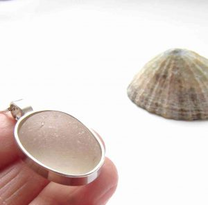 White English Sea Glass Bezel Pendant. A 'Made to order' unique silverwork pendant made to order with frosted white sea glass which I collect in the region of of Northumbria, England, in the UK. I hand-craft the sterling silver bezel, using silverwork techniques, around the unique shape of the piece of sea glass.