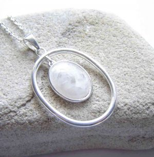 Handcrafted British Quartz Crystal Pendant. A sterling silver double pendant necklace in handcrafted, natural, British quartz crystal. I have collected this natural white gemstone in the Northumbrian region of England, Britain.