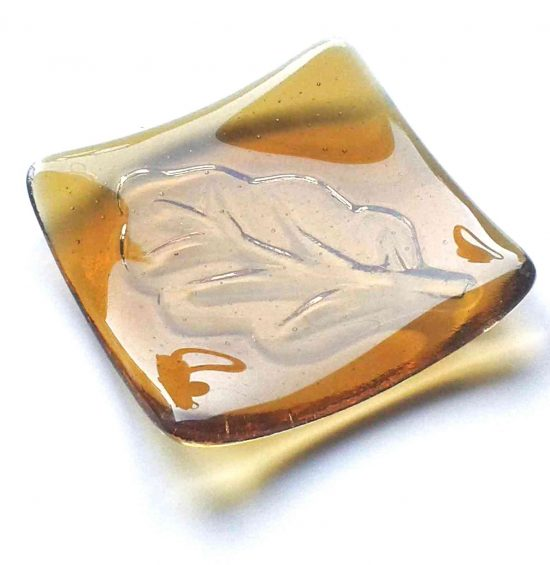 Amber glass leaf jewellery dish. This small jewellery or trinket bowl is handcrafted individually in dark amber glass. Made in north-east England.