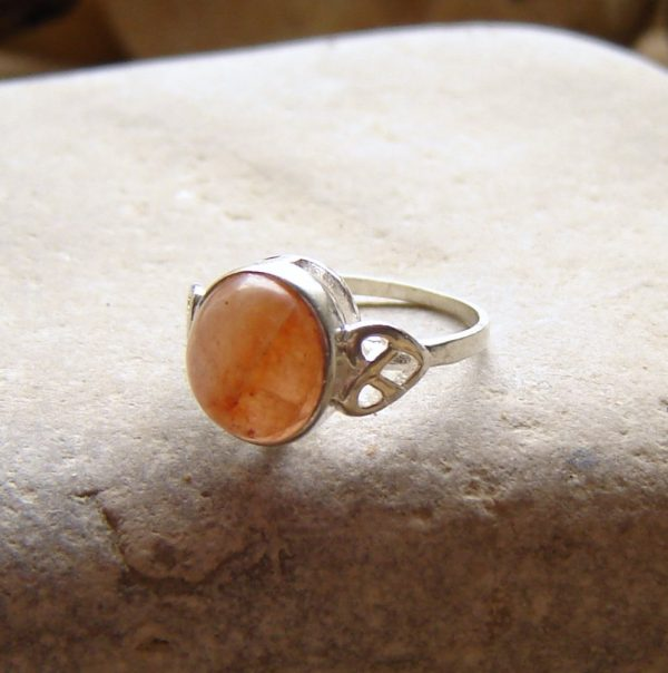 Orange Carnelian Celtic Knot Ring in natural untreated British carnelian gemstone from the North East of England, set in sterling silver.