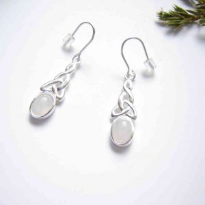 Celtic Drop Earrings in Natural White Quartz found, cut and hand-finished into cabochons here in North East England, and set in 925 sterling silver.