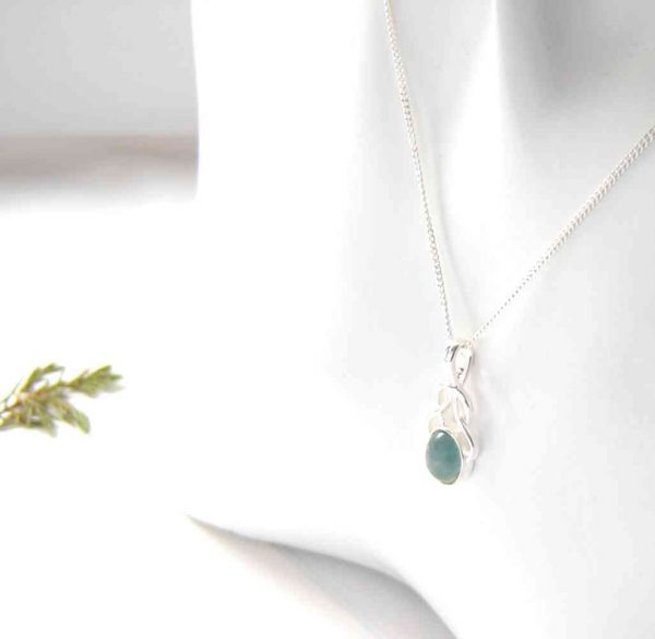 Celtic Knot Apatite Necklace. An apatite gemstone drop pendant necklace in natural, untreated blue green apatite from the Northumbrian coast, England.