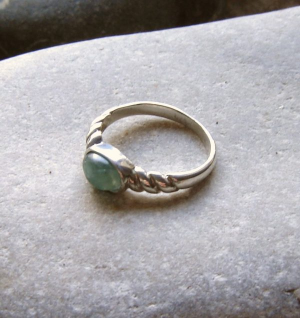 Celtic Rope Twist Ring in Natural Apatite. A small Celtic ring in apatite collected in Northumbria, England.