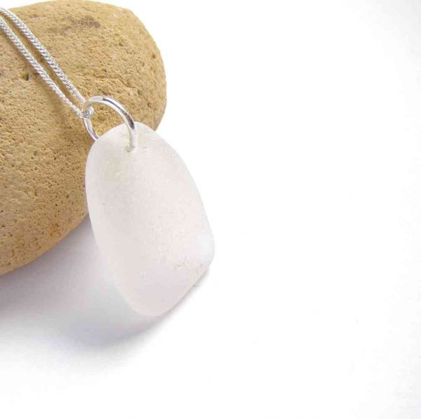 Frosted White Northumbrian Sea Glass Pendant. A sea glass pendant necklace handmade with authentic English sea glass. This sea glass is slightly curved and has been shaped and frosted naturally by the tumbling action of the North Sea off the north-east coast of Britain.