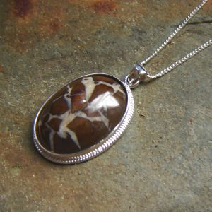 Brown Natural Stone Necklace with White Quartz Veins. Necklace in Brown White Quartz Veins British Stone. Brown English stone pendant necklace in an oval cabochon hand cut from Northumbrian stone into an oval cabochon