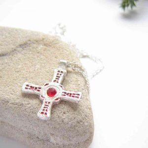 Sea Glass & Silver Rustic 'Cross of St. Cuthbert' Necklace. A small, handmade silver Celtic cross necklace inspired by St. Cuthbert' cross, set with red enamelling and red sea glass from the Durham coast of Northumbria, England.
