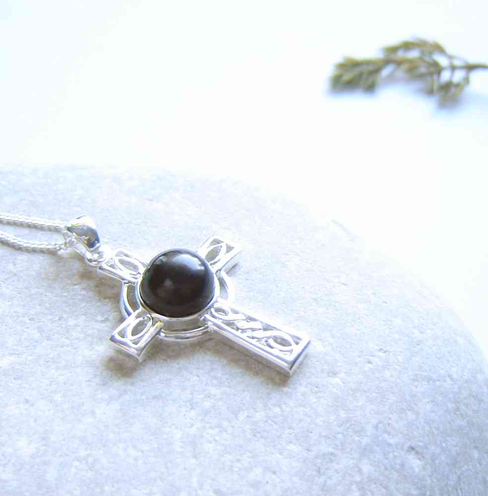 Whitby Jet Celtic Cross Necklace. A Celtic cross necklace in natural black Whitby jet from the North Yorkshire, England (historically in Northumbria). I have handmade the jet into a small, round cabochon, then set it in this sterling silver Celtic cross.