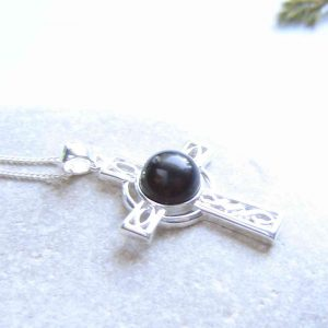 Whitby Jet Celtic Cross Necklace: A hand-crafted black English jet necklace in a sterling silver cross setting.
