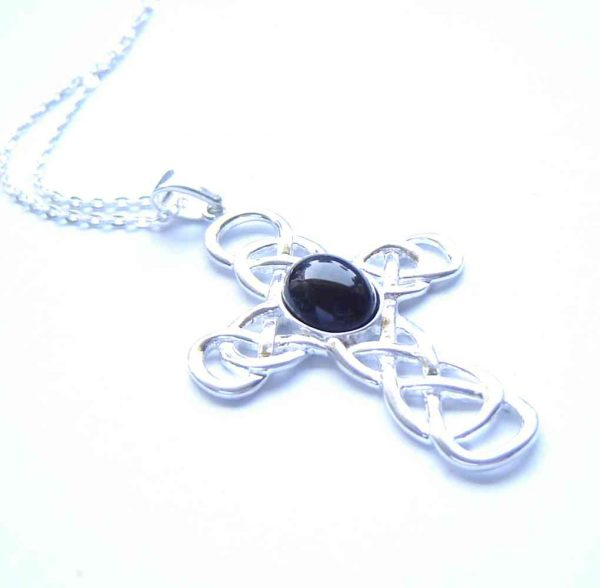 Whitby Jet Large Celtic Cross Pendant. A Celtic cross necklace in natural black jet gemstone from the North Yorkshire coast of England. Whitby is also historically in Northumbria. I handcraft the jet into a small, round cabochon, using lapidary (stonecutting) techniques, to set in this Celtic style sterling silver cross.